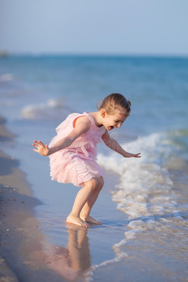 Download Adorable Child Playing At The Beach Stock Photo - Image: 24658416