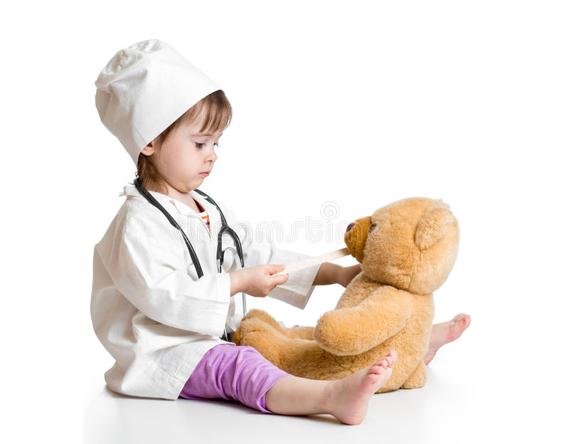 Adorable child playing doctor with toy royalty free stock photography