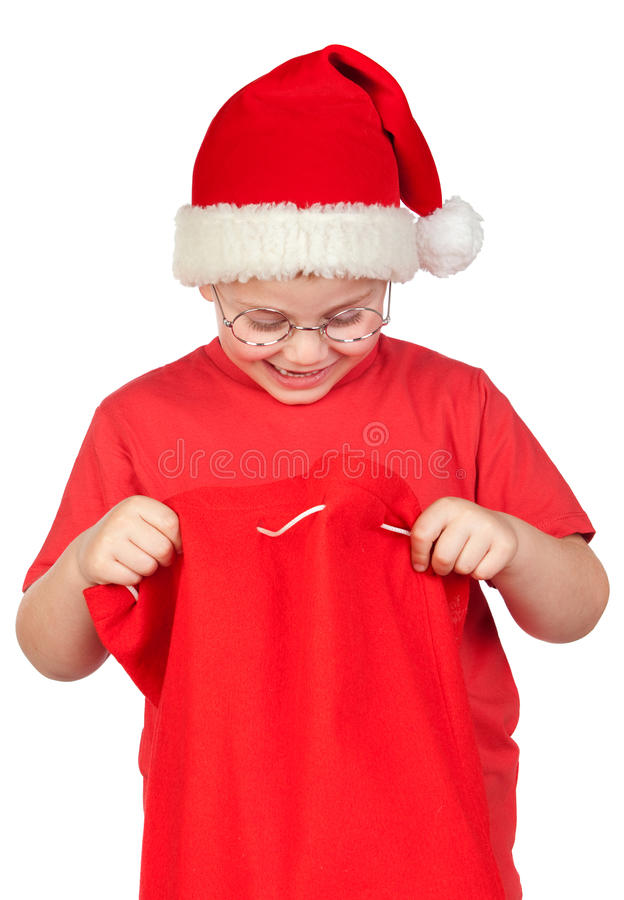 Adorable Child With Santa Hat Looking In Sack Stock Photo