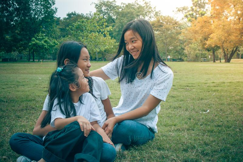 Adorable Concept : Woman and child hugging and feeling smiling happiness in the park. stock photos