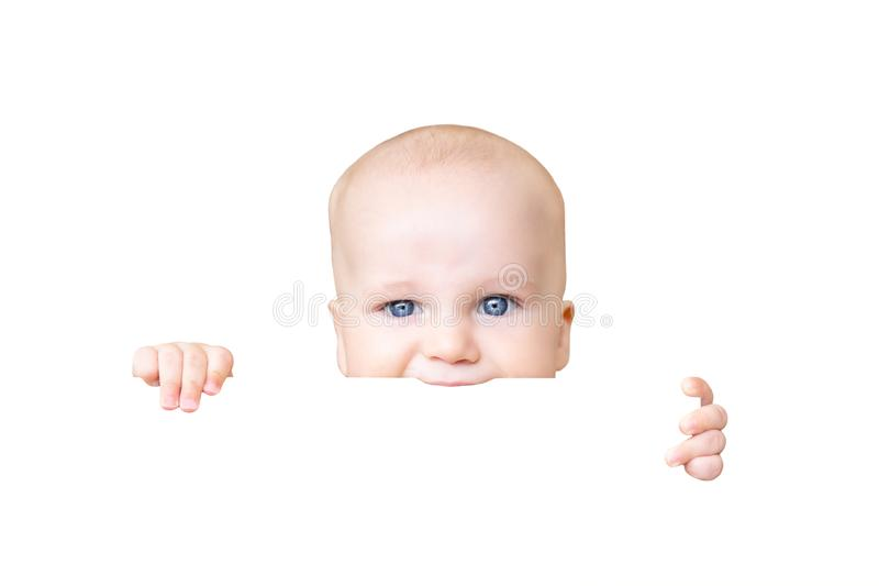 Adorable cute baby boy holding in hand and biting something, isolated on white background.Infant baby teething an. Playing concept royalty free stock photo