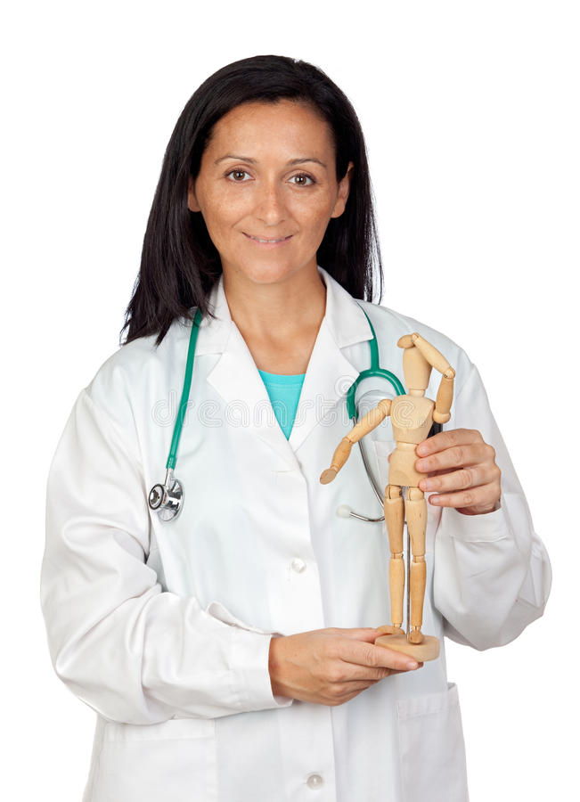 Adorable doctor with a wooden dummy royalty free stock images