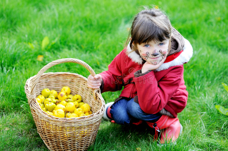 Adorable face painted child girl in the garden royalty free stock photography