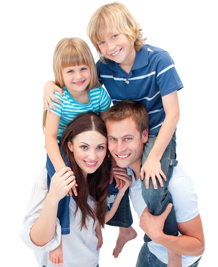 Adorable family enjoying piggyback ride royalty free stock images