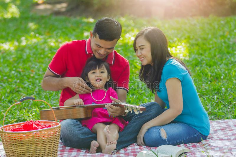 Adorable family on picnic stock photo