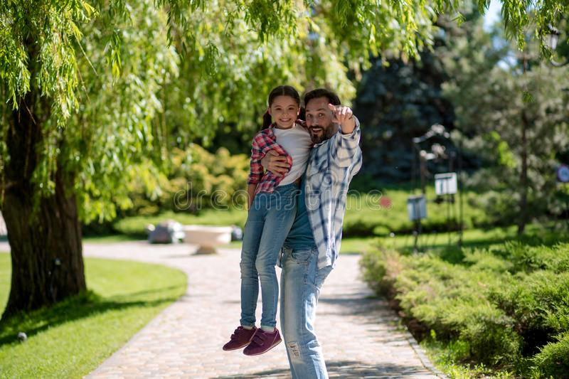 Adorable father and daughter have fun together stock images