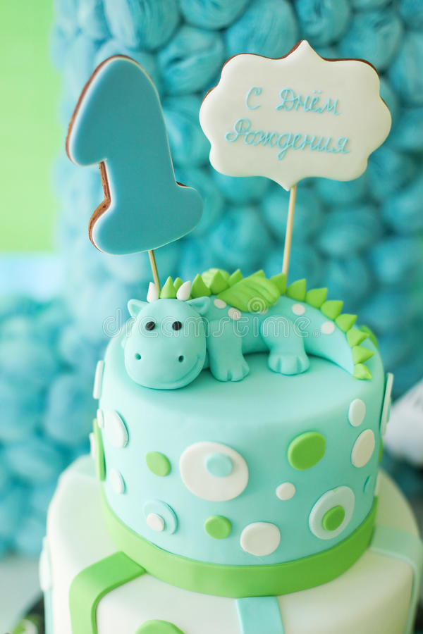 Adorable first birthday cake with dragon royalty free stock photo