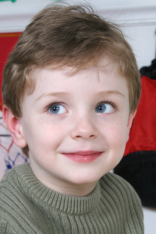 Adorable Four Year Old Boy with Big Blue Eyes stock image