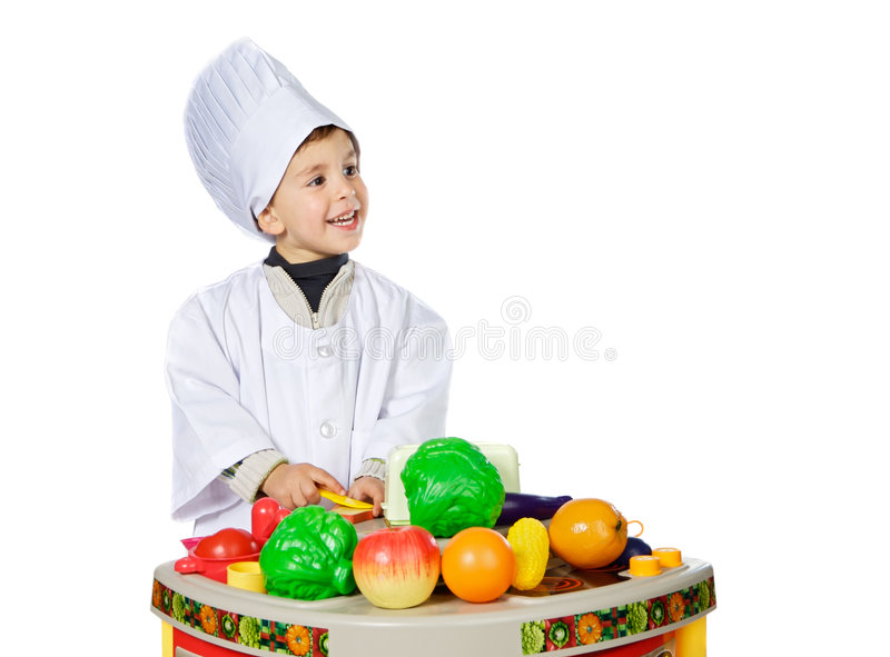 Adorable future cook. A over white background stock photography