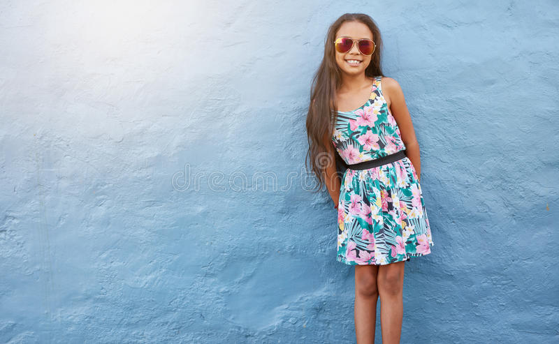 Adorable girl in beautiful dress and sunglasses stock photography