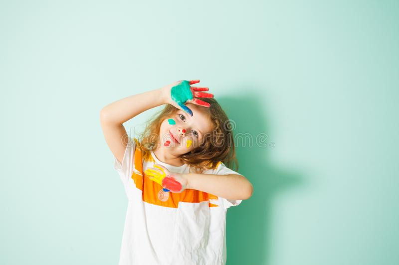 Adorable girl with colorful dots on her face royalty free stock photo