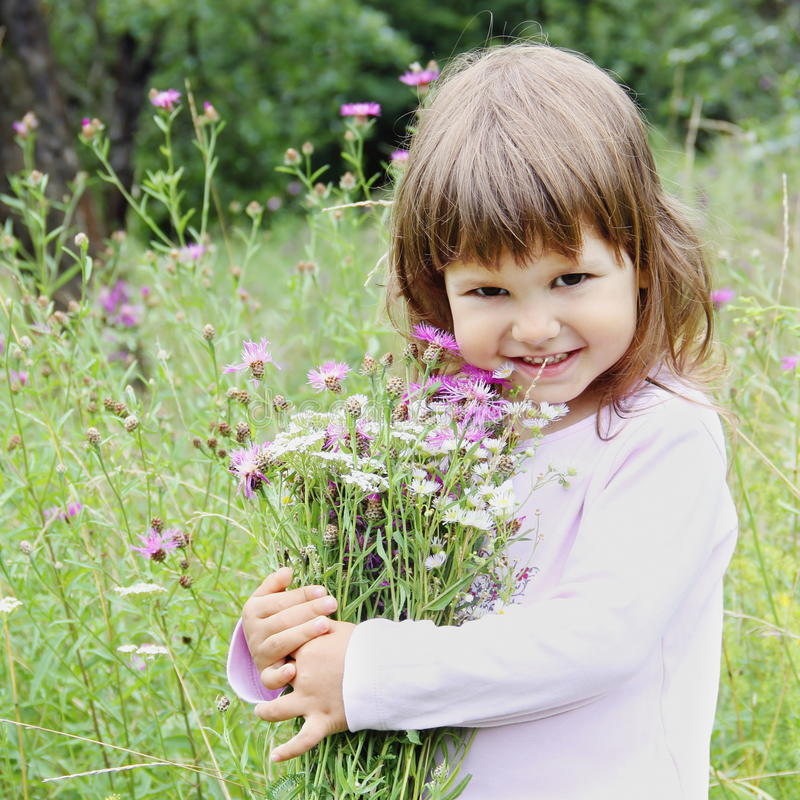 Download Adorable Girl With Bunch Of Flowers Stock Image - Image: 20496983