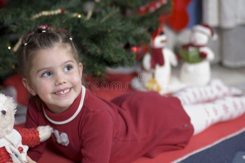 Adorable girl at Christmas time royalty free stock photography