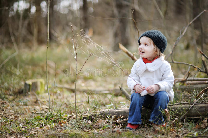 Adorable girl on early spring or autumn. Adorable girl having fun on early spring or autumn stock images