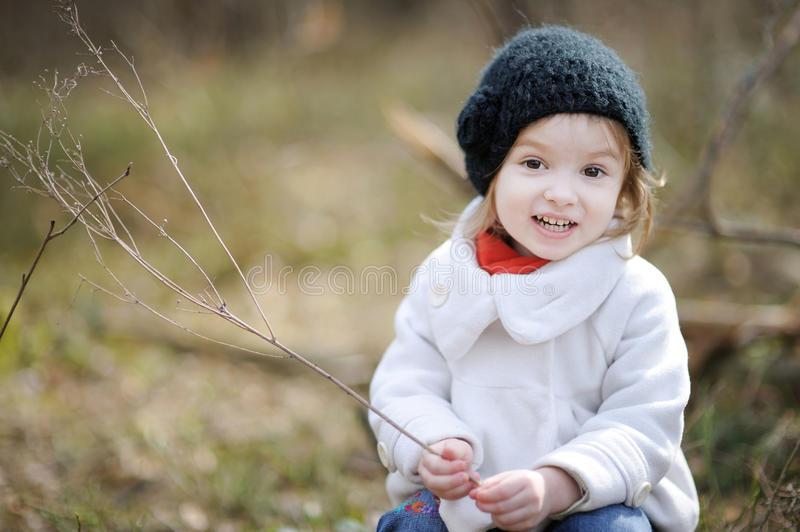 Adorable girl on early spring or autumn. Adorable girl having fun on early spring or autumn stock photos