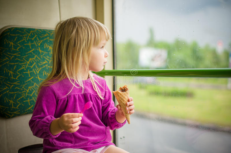 Download Adorable Girl Eat Ice Cream Riding Bus Stock Image - Image of healthy, baby: 25741933