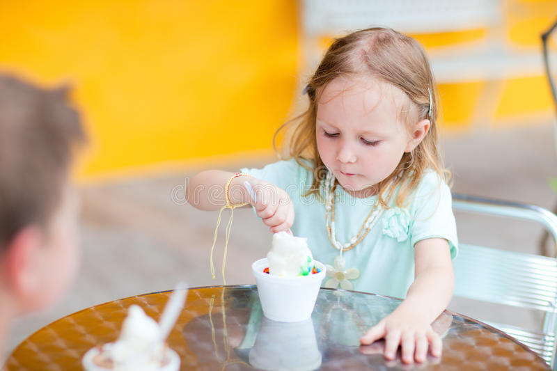 Download Adorable Girl Eating Ice Cream Stock Image - Image: 25371679