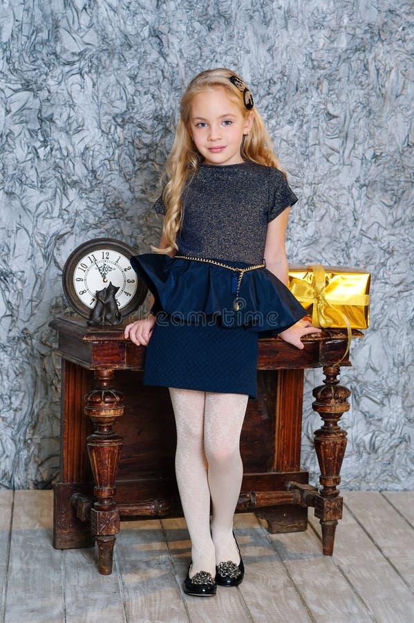 Adorable girl in elegant dress stock image