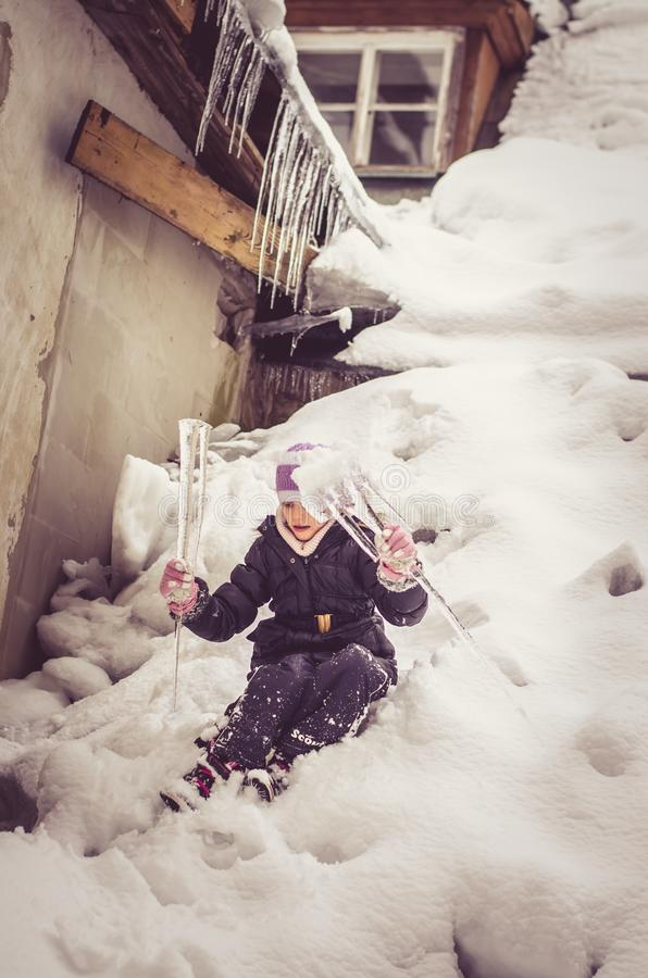 Happy winter time with lot of snow and icicles royalty free stock photo