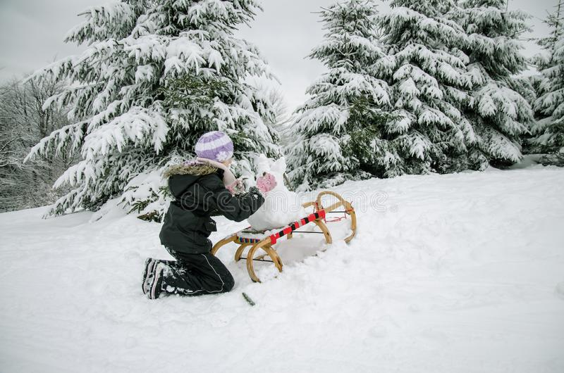 Happy winter time with lot of snow and little snowman stock photography