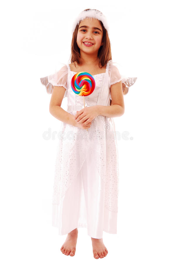 Adorable girl holding lolly pop stock images