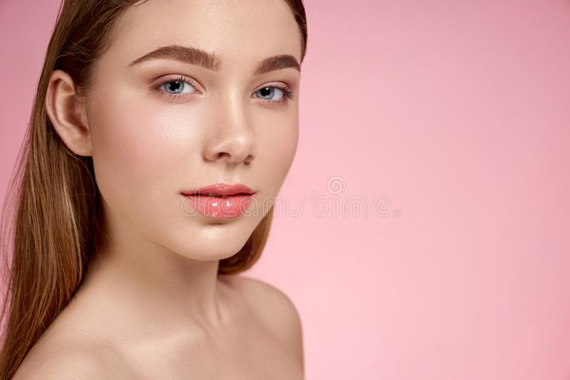 Adorable girl with perfect soft skin looking at camera royalty free stock images