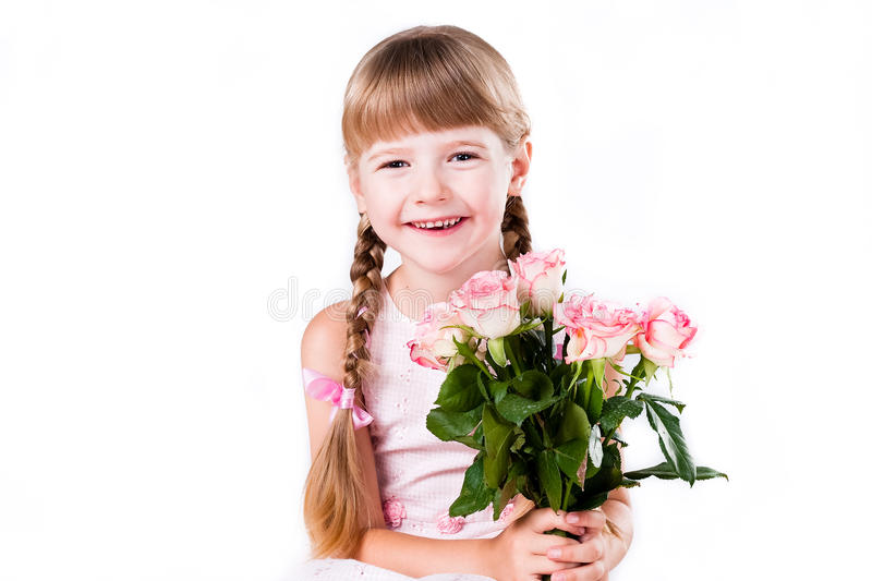 Adorable girl with pink roses isolated on white stock photo