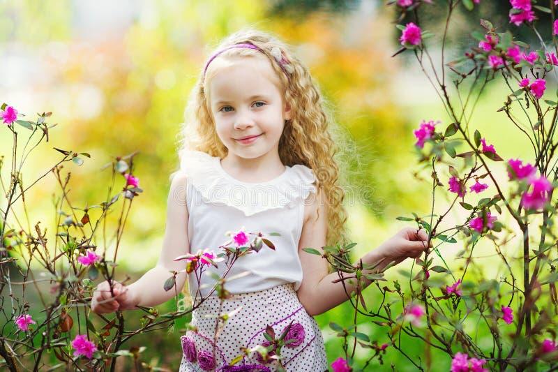 Adorable girl in the spring garden royalty free stock photography
