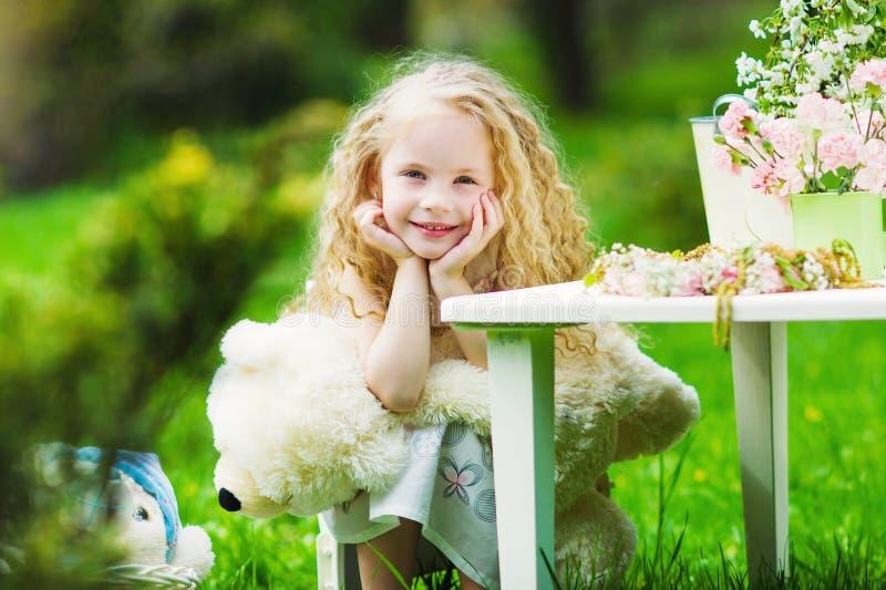 Adorable girl in the spring garden royalty free stock photo