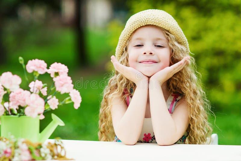Adorable girl in the spring garden royalty free stock photos