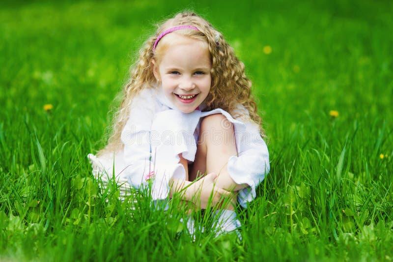 Adorable girl in the spring garden stock images
