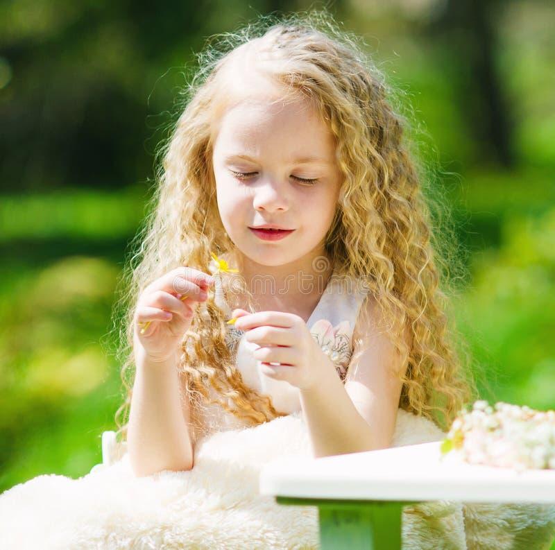 Adorable girl in the spring garden stock photography