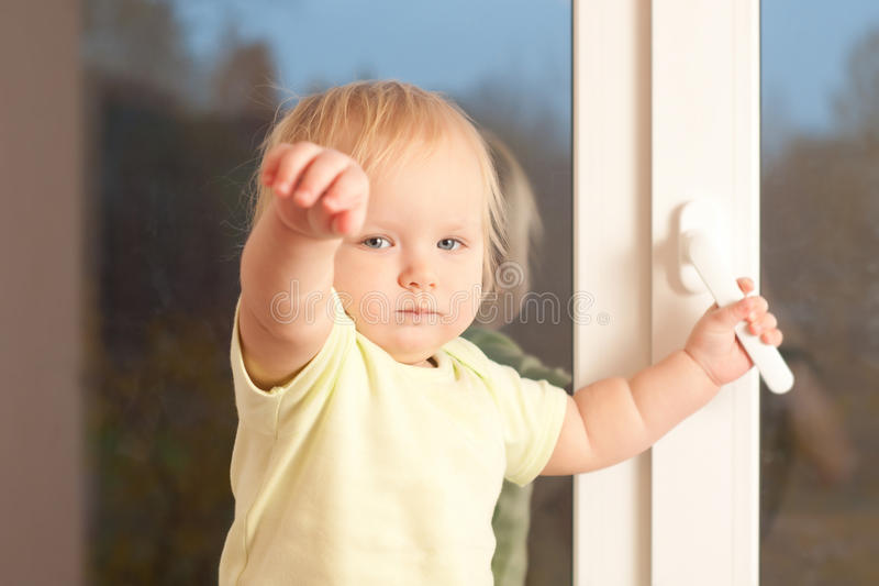 Adorable girl stay on the window sill royalty free stock image