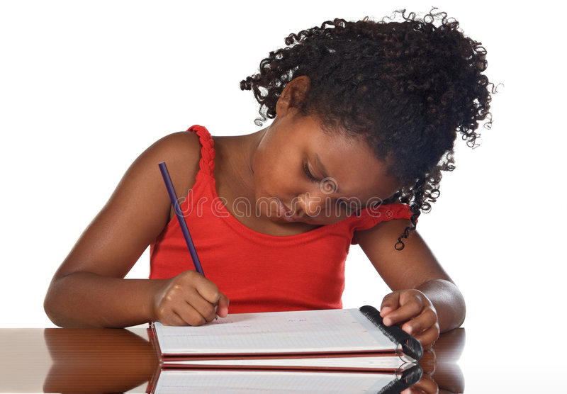 Adorable girl studying stock images