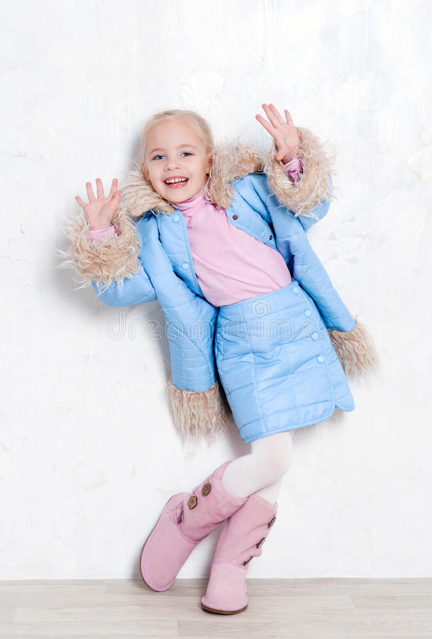Adorable girl in winter outfit stock photography