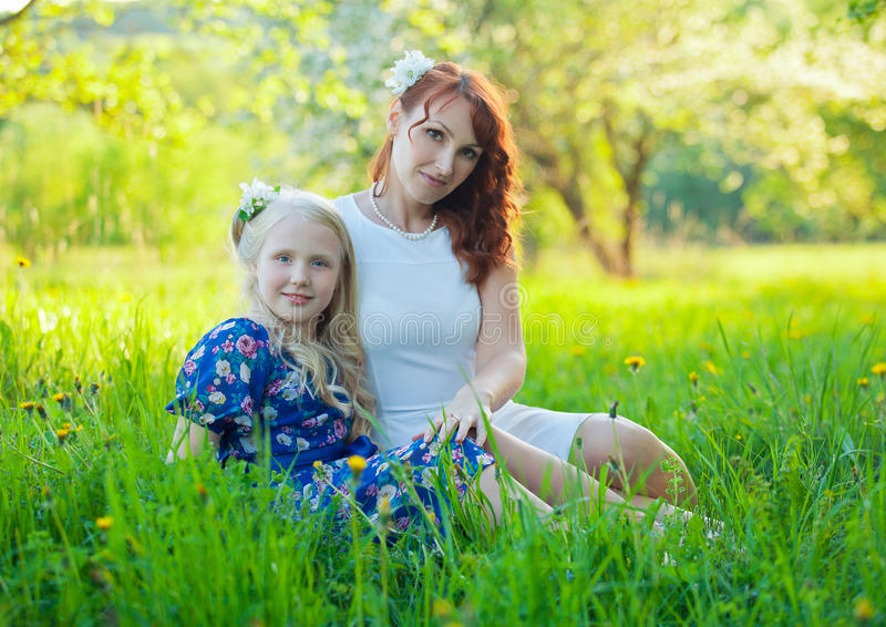 Adorable happy baby girl with mother in a royalty free stock photo