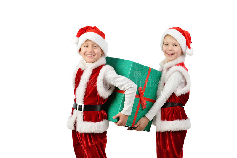 Adorable happy boys in santa clothes holding Christmas gift box. Isolated white background. stock photo
