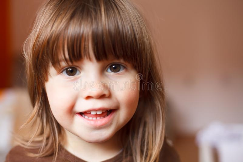 Adorable happy cute laughing smiling toddler girl. Looking at the camera royalty free stock photography
