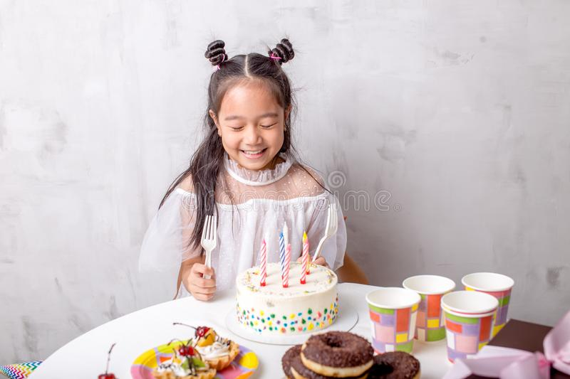 Adorable happy girl having birthday party at home stock photos