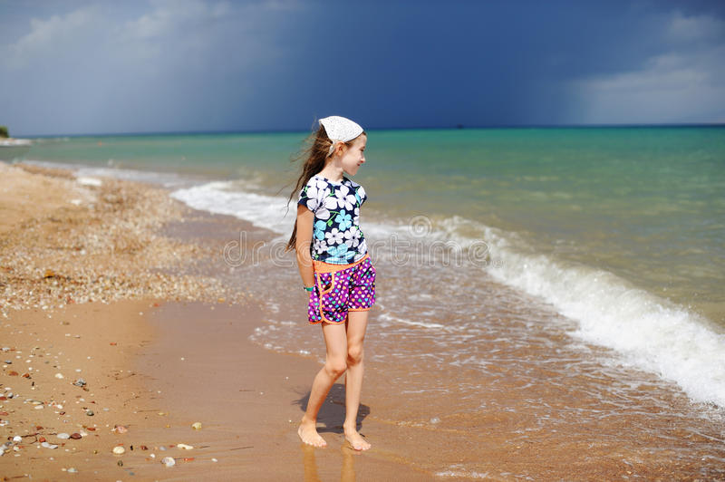 Adorable happy little girl on beach vacation royalty free stock photography