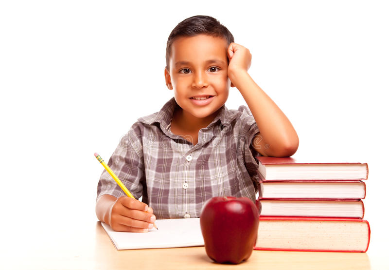 Adorable Hispanic Boy with Books, Apple, Pencil an stock image