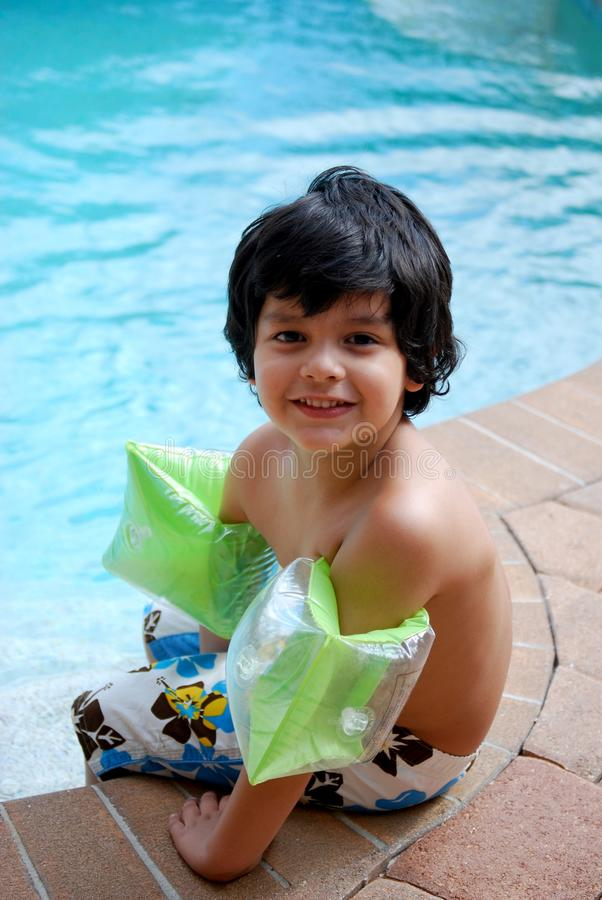 Adorable Hispanic boy by the pool royalty free stock image