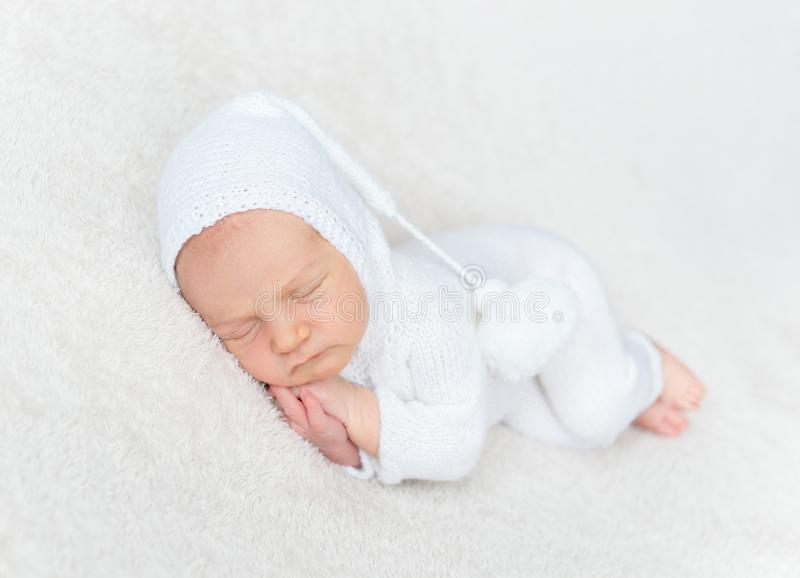 Infant boy in white bodysuit royalty free stock photography