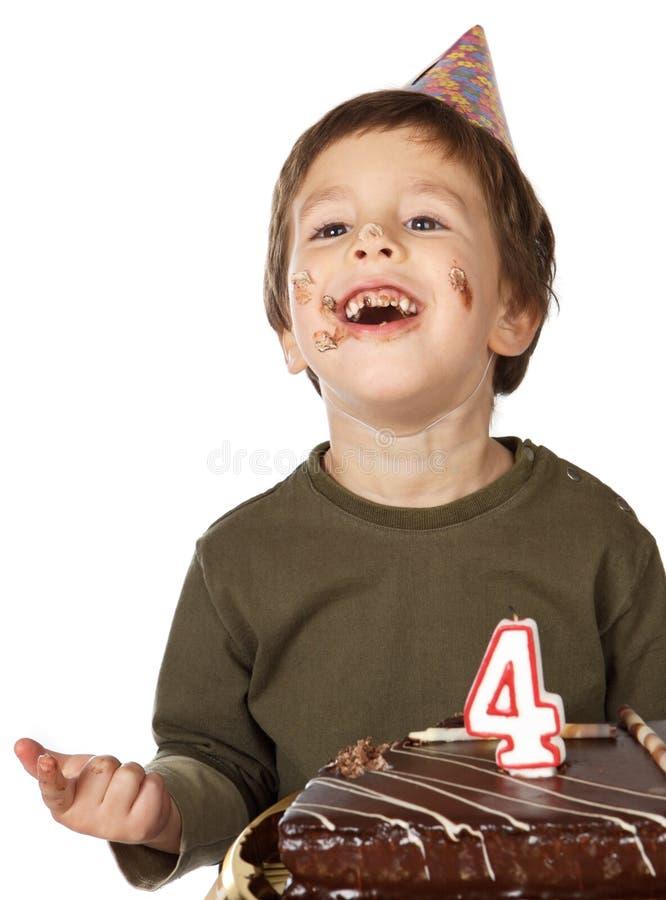 Adorable kid celebrating his birthday. Photo of an adorable kid celebrating his birthday stock photography