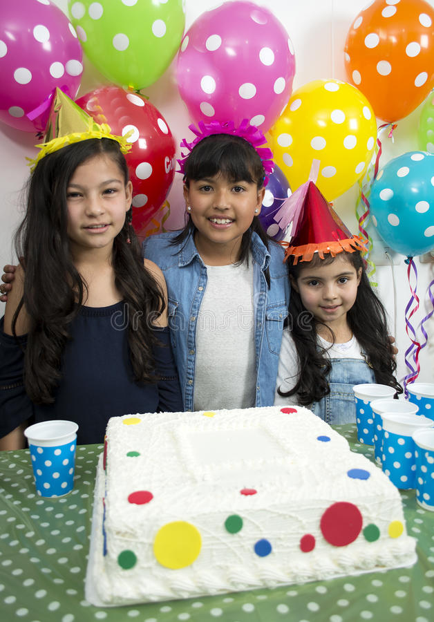 Adorable kids having fun at birthday party. royalty free stock images