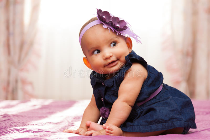Adorable little african american baby girl looking - Black people stock image