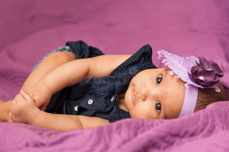 Adorable little african american baby girl looking - Black people royalty free stock image
