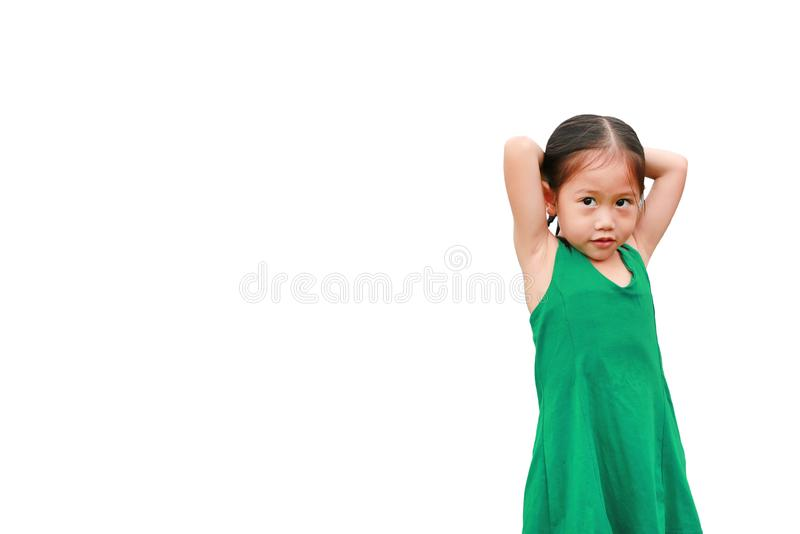 Adorable little Asian child girl standing and posture isolated on white background royalty free stock photo