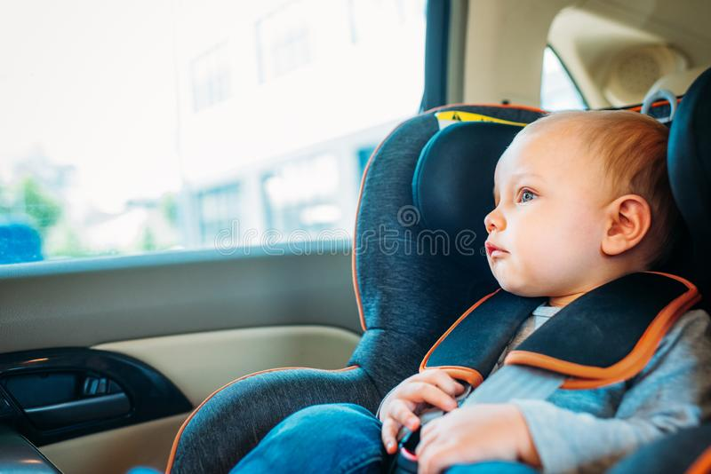 adorable little baby sitting in child stock images