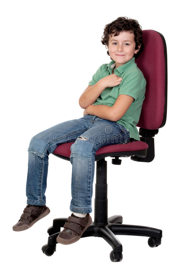 Adorable little boy sitting on big chair royalty free stock images